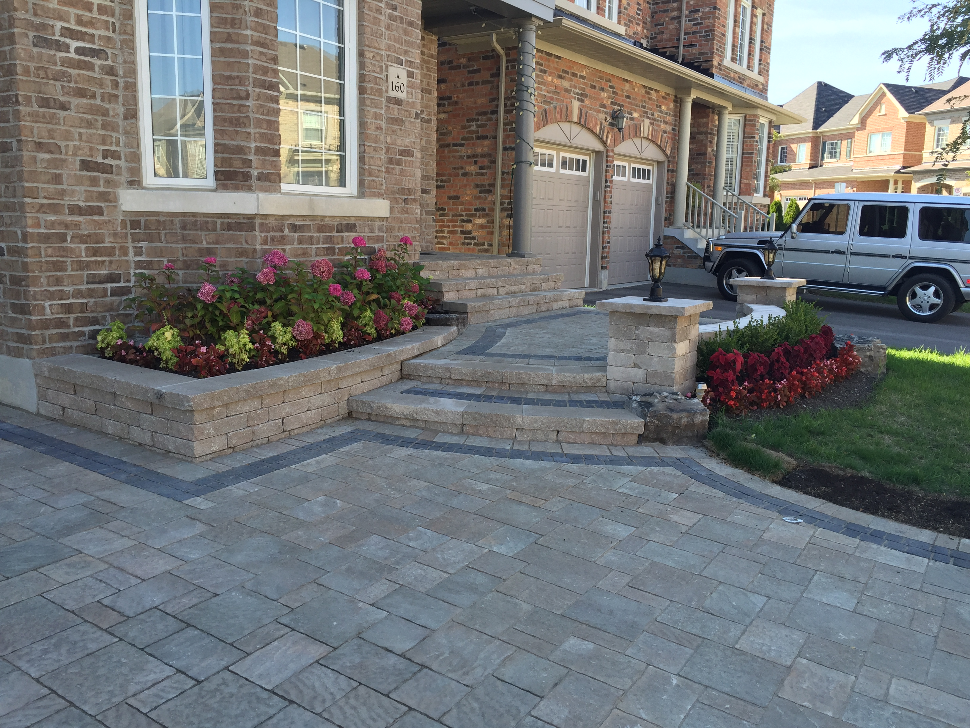 Front Interlocking Stone Driveway and Steps With Accent Lights